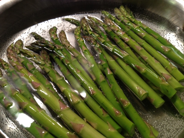 Starting to blanch the asparagus(cooking short time in boiling water- dunking on cold to halt the cooking)