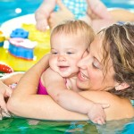 lady with baby in pool